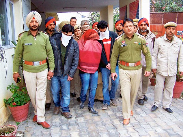 24A5569600000578-2907038-Accused_tutor_Radha_centre_and_her_brothers_masked_after_being_t-a-38_1421124182314
